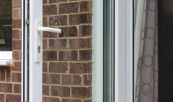 An open patio door with locking features